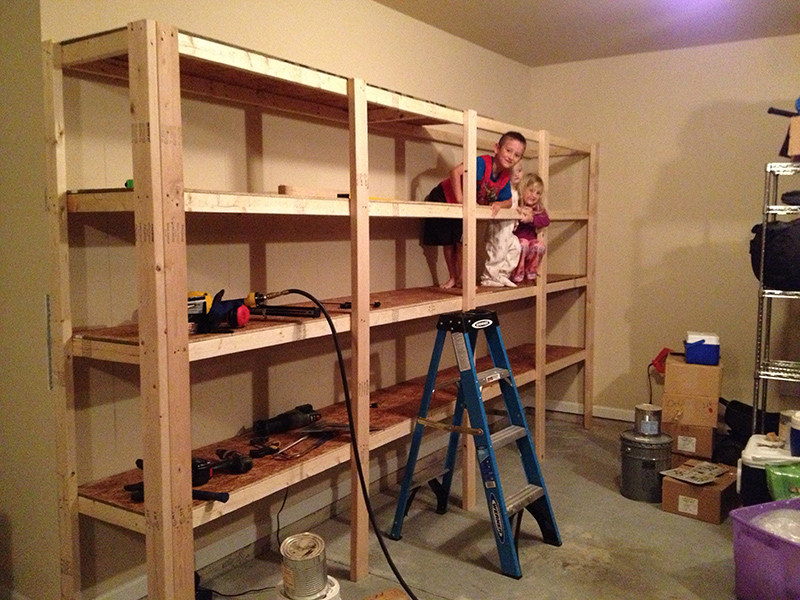 building wooden shelves in shed
